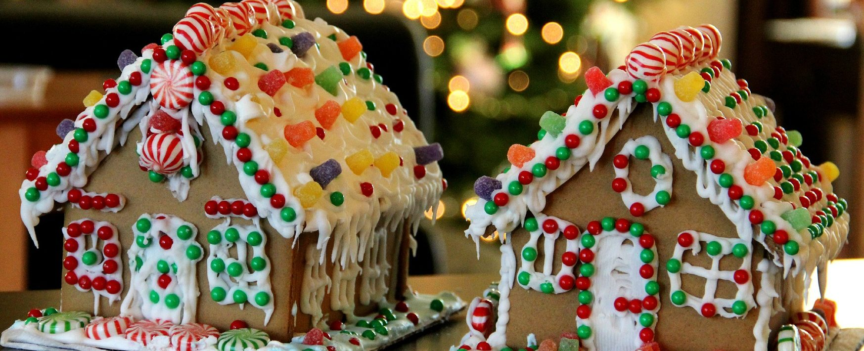 Two Gingerbread houses decorated with icing and sweets